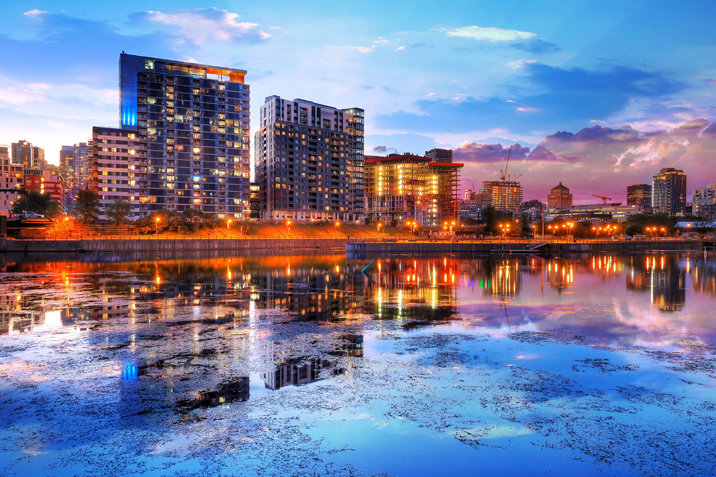 2020 Downtown Montreal City Water Reflection at Sunset Stock Image