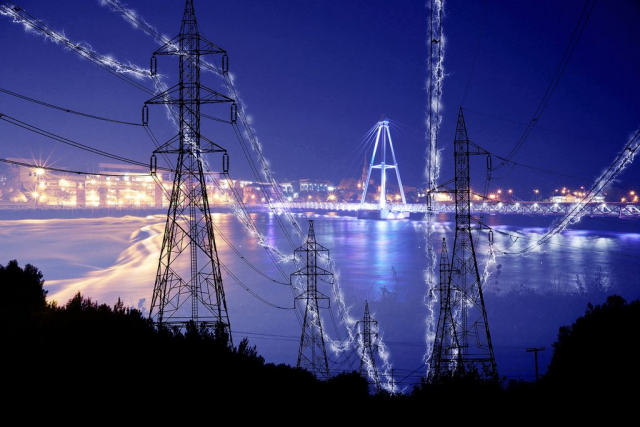 Small Town Electrification at Night in Blue Stock Image